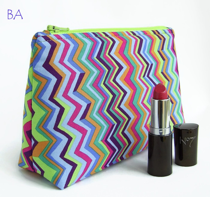 Funky multi colour make up bag,makeup bag,cosmetics bag in eye catching zigzag stripes. Lime green,purple,pink,jade,lilac,blue,orange. Made in Wales, UK. www.baggieaggie.com.