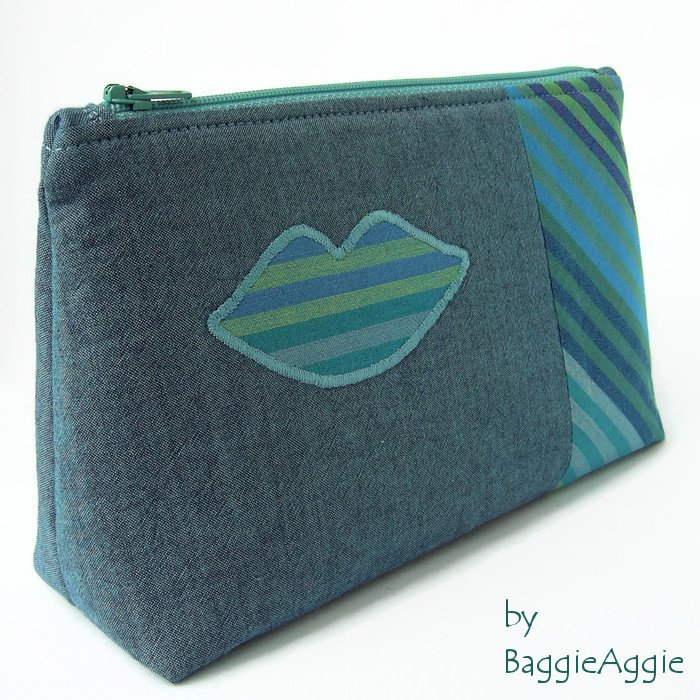 Funky makeup bag with 'lips' applique. Kaffe Fassett cotton fabrics in blue, green, jade, turquoise. Made in Wales, UK. www.baggieaggie.com.