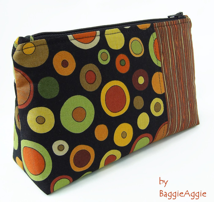 Unique make up bag / cosmetics bag in funky spots and stripes fabric. Orange, yellow, green, brown and black. Made in Wales, UK. www.baggieaggie.com.